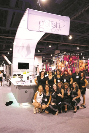 <p>The Hand & Nail Harmony booth is all smiles at the Las Vegas show in 2012.</p>