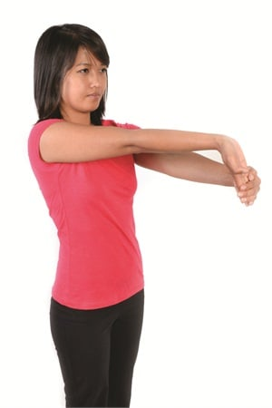 <p>While standing or sitting, fully extend your right arm until the elbow is straight in front of you. Use your left hand to gently bend the right wrist and fingers backwards, with palm facing out, until you feel a mild stretch. Hold for 15 seconds.</p>