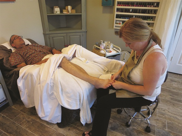 Charlie is blissing out in the zero-gravity chair during his Farmhouse Fresh Spa Pedicure!