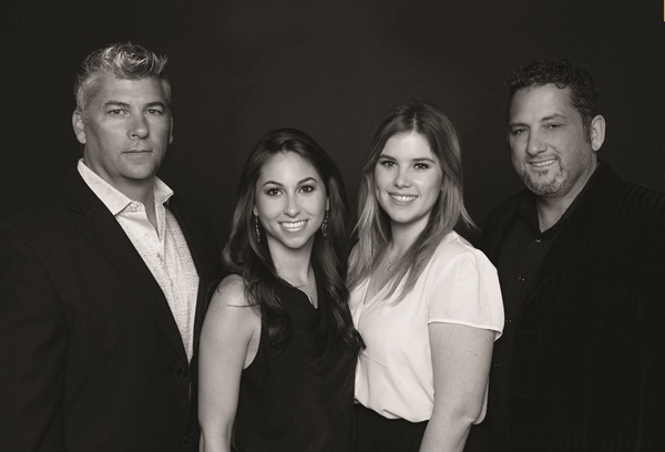<p>This family portrait shows Danny Haile, Haile's daughter Morgan, Daniel's daughter Taylor, and David Daniel.</p>