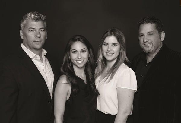 <p>This family portrait shows Danny Haile, Haile's daughter Morgan, Daniel's daughter Taylor, and David Daniel.</p>