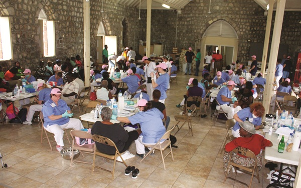 Volunteers are hard at work during the four-day free foot care clinic to help residents of St. Kitts.