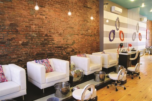 <p>Modern spa pedicure stations add to the salon's upscale and chic image.</p>
