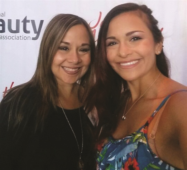 <p>Annette Calvillo and Kayleigh Eaton take a selfie at the International Salon and Spa Expo.</p>