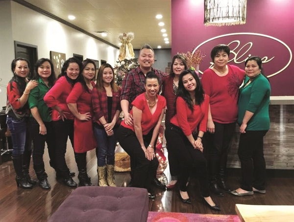 <p>Linda Duong, husband Ty Vo, and the Bliss staff pose for a picture in the salon lobby.</p>