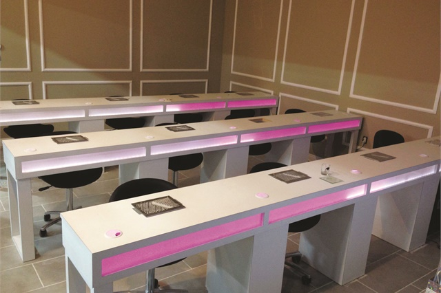 <p>The desks in the Skyline Nail Academy have built-in neon LED lights that can be controlled by phone.</p>