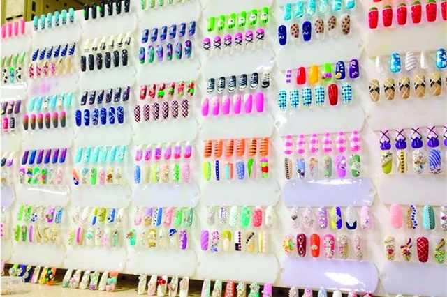 <p>A display of nail tips demonstrates what you can accomplish with the nail art supplies available at the store.</p>