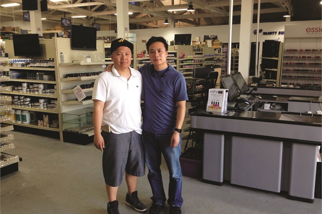 <p>Skyline owner David Ngo (left) poses with his brother Johnny Ngo, who owns Whale Spa.</p>