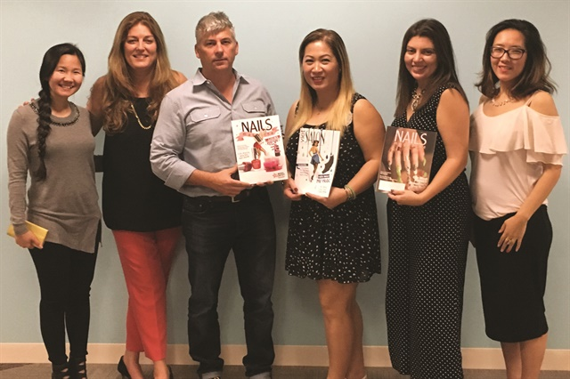 <p>Danny Haile (center) wanted Gelish's newest product, PolyGel, to be odorless, a health benefit for clients and techs alike. From left to right: VietSalon managing editor Anh Tran, publisher Michelle Mullen, Gelish's Thao Nguyen, me, and associate art director Yuiko Sugino.</p>