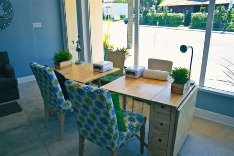 <p>The bright blue and green decor was inspired by a cheerful headband that owner Joezette Hite happened to be wearing one day.</p>