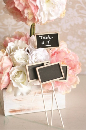 "<p>Chic chalkboards on sticks for table numbers. <em>Photo courtesy of <a href=""http://etsy.com/shop/braggingbags"">etsy.com/shop/braggingbags</a></em></p>"