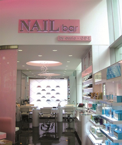 <p>As a modern-styled space with bubbly chandeliers, sleek furnishings, and rotating product displays, the Nail Bar's appearance is impressive, especially when you consider that it's inside a major drugstore chain.</p>