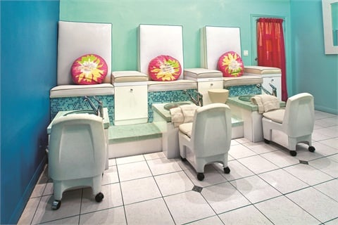 "<p class=""NoParagraphStyle"">Pink pillows and curtains add a splash of color to this sea-themed pedicure alcove.</p>"