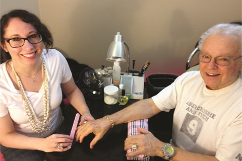 "Melissa Stephens, here with client Ron Oates, says, ""I think guys are coming around to the same realizations that women have had for a while now. That having neat hands,  nails, and groomed cuticles shows you care enough to take care of yourself and makes you feel more put together."""