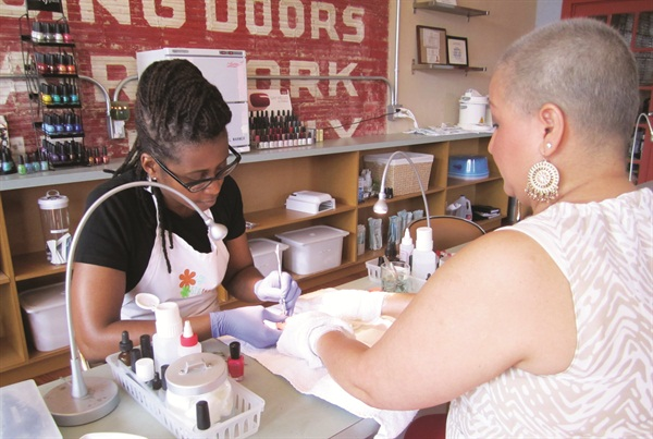 """I admit, and have even been told, that I can be a bit anal when it comes to keeping my salon nice and clean. Sanitation was high on my priority list even before I started working with at-risk clients,"" says SPAtaneity LLC founder Missy Malone, shown here performing a manicure on a client with cancer."