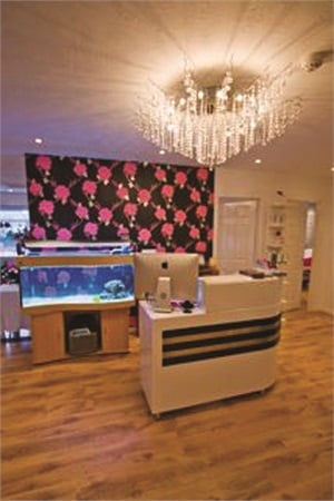 Polish Nail & Beauty's waiting area features an elegant chandelier and fish tank. According to the salon's website, Polish Nail & Beauty is New York-inspired.