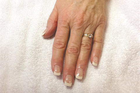off a client's hands than beautiful, classic pink-and-white nails