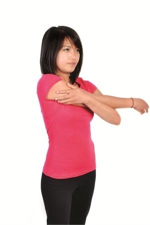 <p>Can be done seated or standing. Bring the right arm straight out in front of you and, without angling it up or down, bring it across your body. It will be slightly above chest level. With the left arm bent at the elbow and anchored against the body for support, hold the right arm in place for a count of 30. Repeat three times.</p>