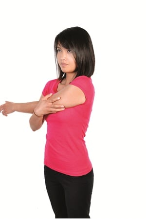 <p>Switch sides, bringing your left arm out straight and then across the body. Use the right arm to hold it in place for 30 seconds. Repeat three times.</p>