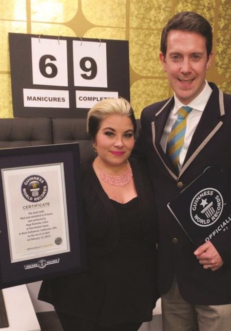 <p>Naja Rickette with Guinness World Record representative Philip Robertson.</p>