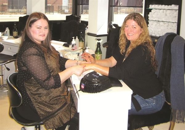 <p>Luzaj gave NAILS publisher Michelle Mullen a Moroccanoil Mani.</p>