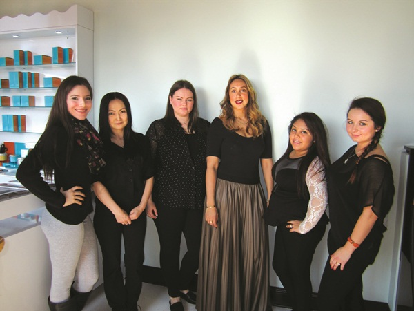 Julissa Hernandez, Azaa Tserendagva, Esmerelda Luzaj, owner Carla Alvarado, Stephanie Aguilar, and Gladysh Nelia keep things running smoothly at Hush Nail Boutique in the Lincoln Park neighborhood of Chicago.
