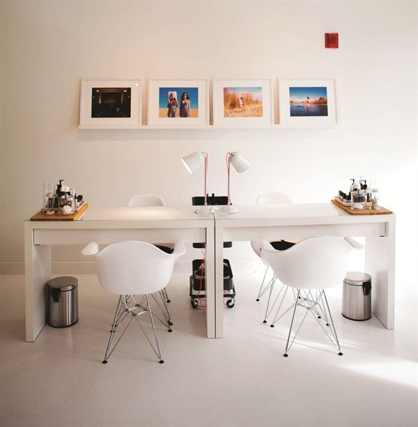 The salon maintains a gallery space for local female artists to display and sell their artwork.