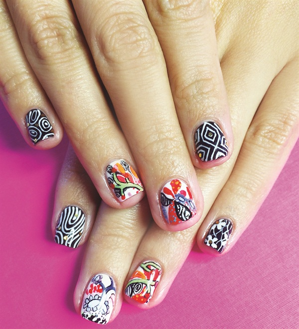 The artist maintains a binder of various backgrounds that she uses to photograph nails against.