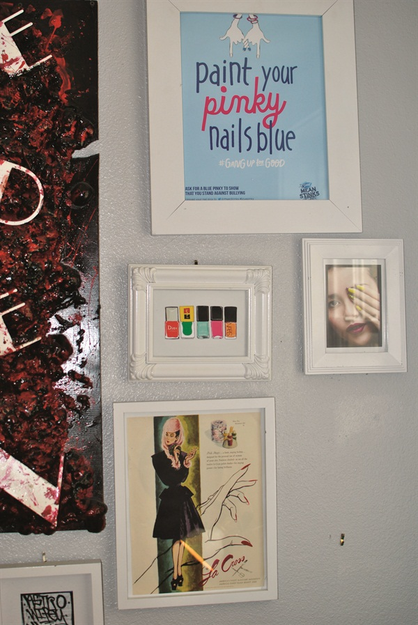 <p>Astrowifey is a fan of all forms of art. Various nail prints and ads hang in white frames around her studio.</p>