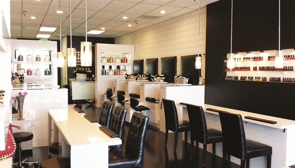 GLO's decor consists of a simple color palette of black and white to highlight the wide selection of polish colors.