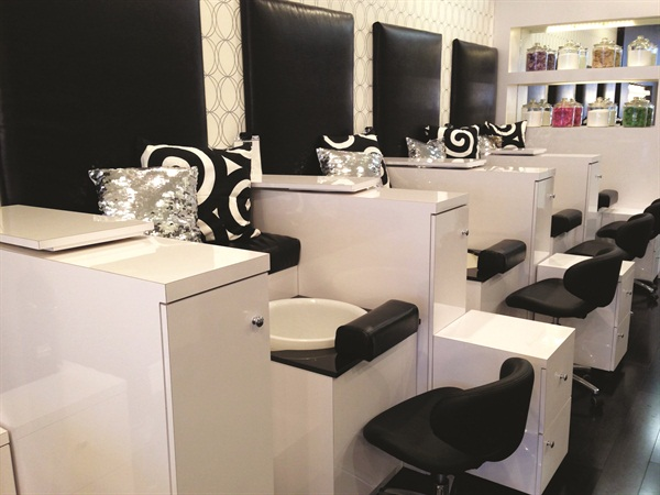 Clients walk up stairs to get to the pedicure station, while the nail tech brings over the pedicure tub with whichever treatment the client has selected.