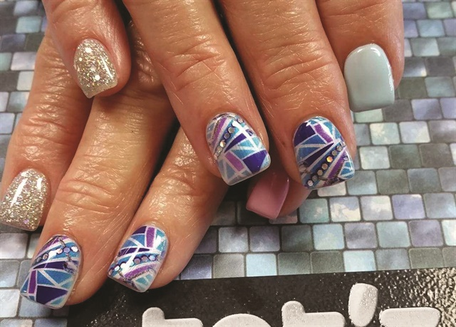 Instagram followers of Buddy Sims (@buddysimsnails) enjoy a nail art feed that includes designs created by Tat'z Nailz printers, including this one with post-print nail tech-placed embellishments.