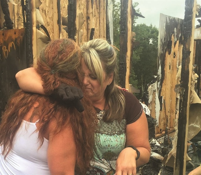 <p>Eades gets a hug from salon co-owner and best friend Ronda Howell. </p>