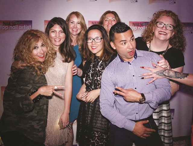 <p>One of my favorite pics from the NTNA party, because a big part of teamwork is having fun! Left to right: art director Danielle Parisi, me, sales rep Shannon Rahn, associate art director Yuiko Sugino, publisher Michelle Mullen, the ever cheeky Dennis Godar, and COO Cyndy Drummey. The nails belong to NTNA Top 12 competitor Liza Waitzman. </p>