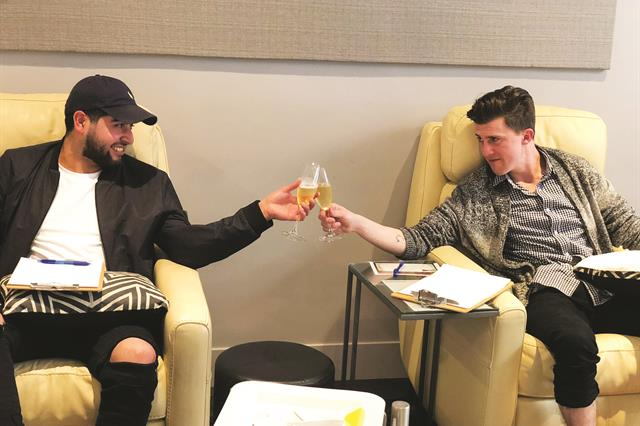 Zaza Nail and Wine Lounge invited these two men to cheers to their first-ever nail salon service.