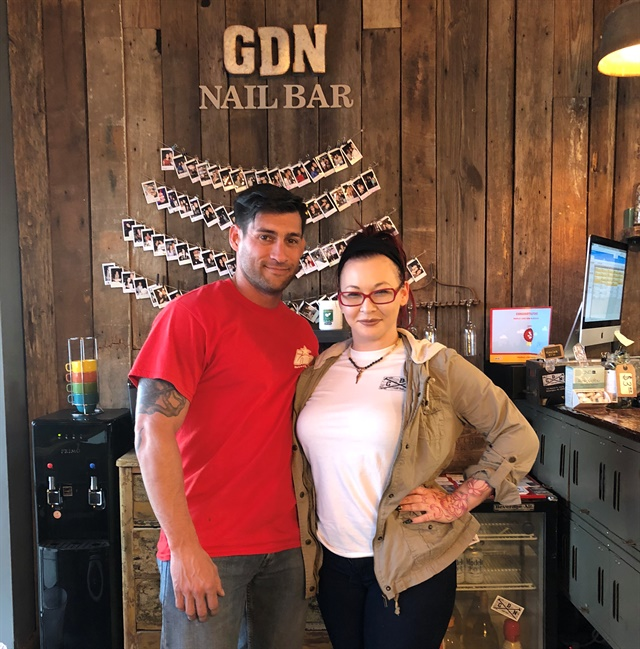"Nail tech Kelly Prettyman and Schuman, who considers himself a ""roughneck"" but was willing to give the pampering a try!"