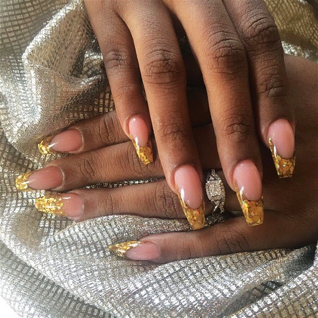 Tashida Callender's husband, Kevyn Callender of St. Michael, Barbados ( @dr.k.picasso), did her nails the night before their wedding. Married December 2, 2017.