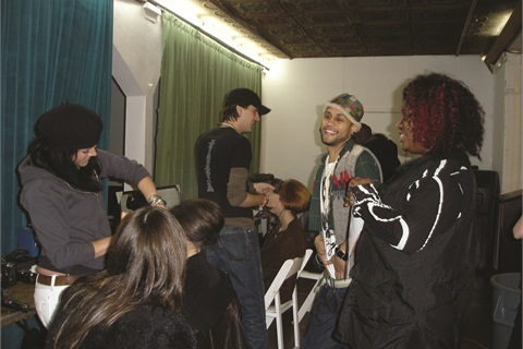 <p>Honey (far right) catches up with other artists during her down time.</p>