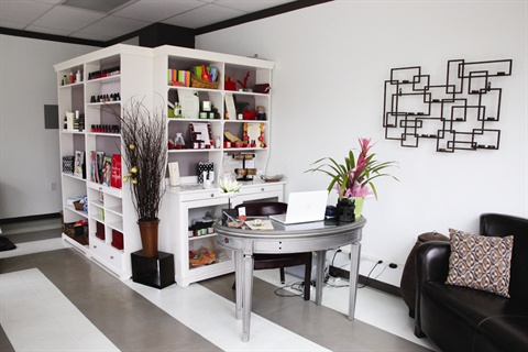 <p>The salon's mini-library holds an assortment of books that are always available for clients to borrow and bring back on their next visit.</p>