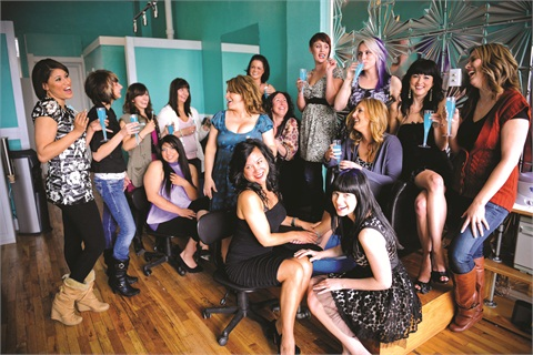 "<p class=""NoParagraphStyle"">Featured above is a handful of Tootsies' nail techs and employees, including founders Castle (sixth from left) and Lauren Searcy (seated in foreground). </p>"