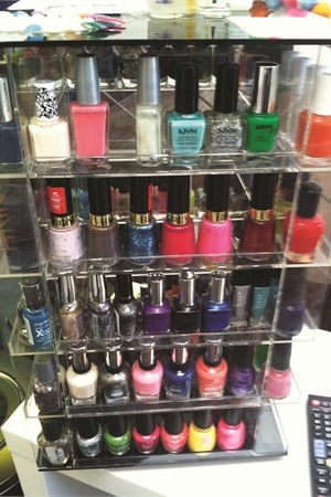 <p>Another unique trait of this salon is its polish exchange, where clients can bring in polish they don't want anymore and trade it for one on this rack.</p>