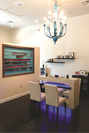 <p>The clean lines, soft blue, and colorful chandelier all work together to create the feel of Hollywood glam.</p>