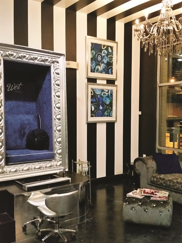 <p>Chandeliers add the perfect touch to this salon. And you have to appreciate the handpainted striped walls and ceiling!</p>