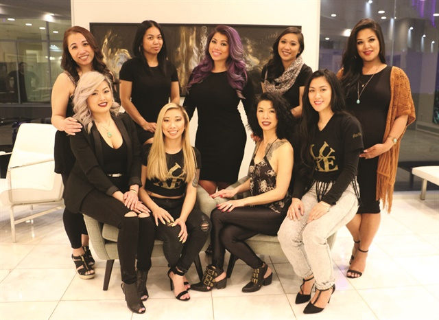 Nguyen says that the nail techs at Luxe are like a family, with very different personalities but a mutual love of nail art. (That's Nguyen in the center with the purple hair.)