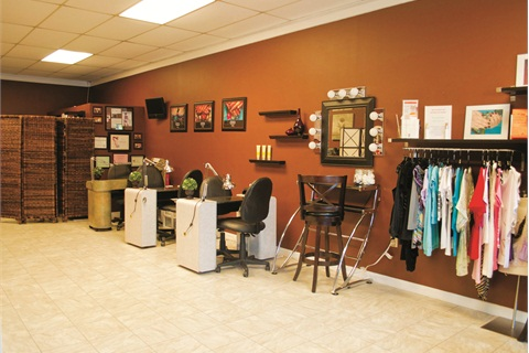 "<p class=""NoParagraphStyle"">Wellness services are conducted behind the manicure tables. In front is another section of Unity's boutique featuring hand-selected articles of clothing.  </p>"