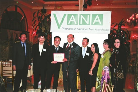 <p>California State Senator Lou Correa presents a certificate of recognition to VANA president Mike Vo. From left to right: Howard Ngo, secretary Thong Vu, president Mike Vo, Senator Correa, vice president John Nguyen, Dee Nguyen (board of directors), treasurer Barbara Trinh, and Lisa Huey (board of directors).</p>