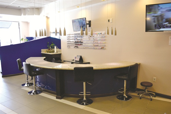 Clients opting for a manicure or some nail art can sit at the nail bar.