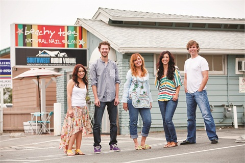 <p>A beach towel-inspired sign beckons passersby to stop by the salon for a specialty manicure or pedicure. (From left to right: Lasette Oropez, Torey Bartu, Pamela Reeder, Taylor Pelchat, Paul Hatch)</p>