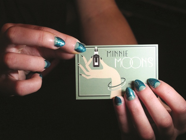 """<p>Even Trickett's business cards have a vintage feel. She advertises her work as """"Vintage-style moonicures for Deco dames."""" Photo Credit: Tony Nylons</p>"""