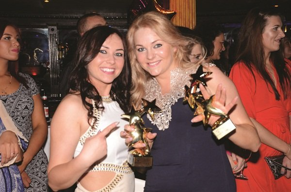 <p>Paulina Zdrada is happy to show off her trophies for Gel Tech of the Year and Gel-Polish Stylist of the Year.</p>